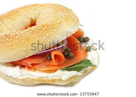 Bagel with smoked salmon, cream cheese, capers, and red onions.  Isolated on white.