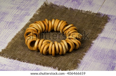 bagels on a wooden table. Rustic style.  Free space for text. - stock photo