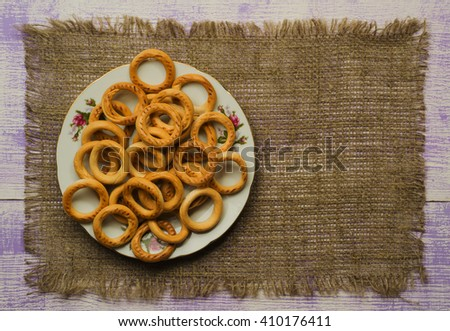 bagels on a wooden table. Rustic style.Top view. Free space for text. - stock photo