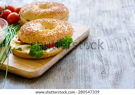 Bagels sandwiches with cream cheese, tomatoes and chives for healthy snack - stock photo