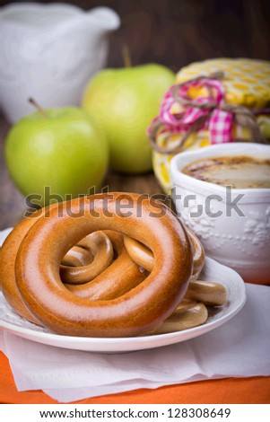 Bagels to tea for a breakfast - stock photo
