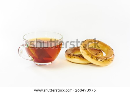 Bagels with poppy and tea on a white background - stock photo