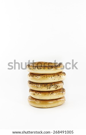 Bagels with poppy seeds on a white background - stock photo