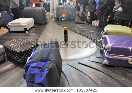 Baggage Claim. Airport Baggage belt with moving luggage in sharp colors - stock photo