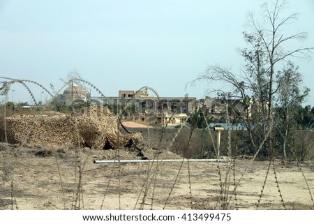 BAGHDAD, IRAQ - CIRCA 2005: Underground bunker area in a former Sadaam palace area converted into a Forward Operating Base.  Razor wire lines the ground