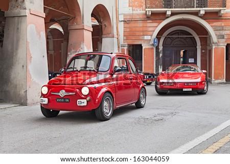 "BAGNACAVALLO, RA, ITALY - NOVEMBER 10: unidentified driver on a red vintage car Fiat 500 runs during the rally ""Meeting Fiat 500 e auto d'epoca"" on November 10, 2013 in Bagnacavallo, RA, Italy - stock photo"