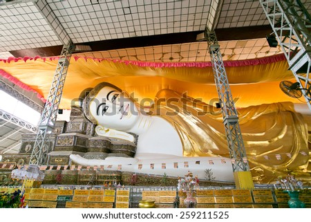 Bago, MYANMAR - MARCH 3 : Shwethalyaung Reclining Buddha on March 3, 2014 in Bago, Myanmar. It is the most famous reclining buddha in Bago, Myanmar. - stock photo