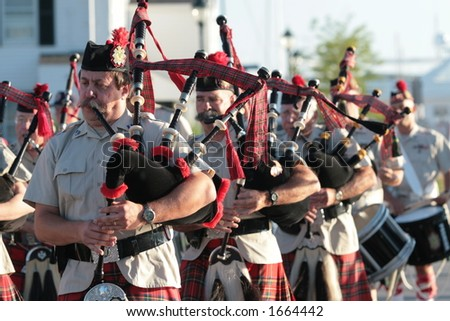 Bagpiper band. - stock photo