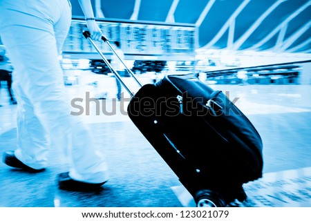 bags at the airport, motion blur - stock photo
