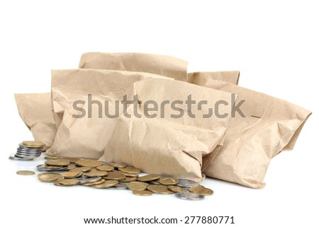 Bags filled with coins. A white background. Isolated. - stock photo