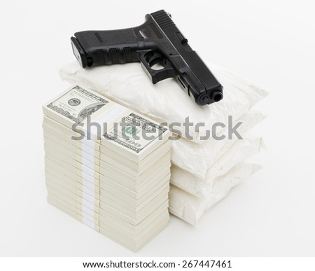 Bags full of drug stack of money and handgun on white background - stock photo
