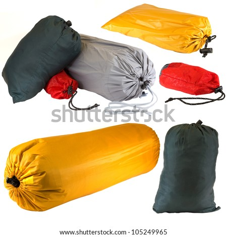 Bags of camping equipment isolated on a white background. - stock photo
