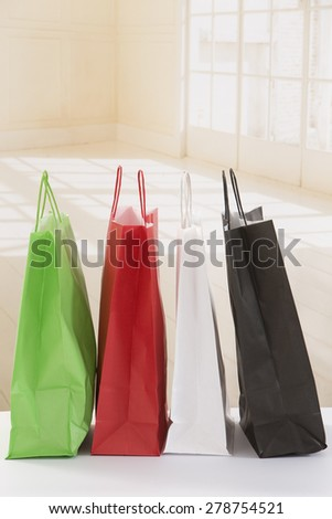 Bags of shopping on living room background close-up - stock photo
