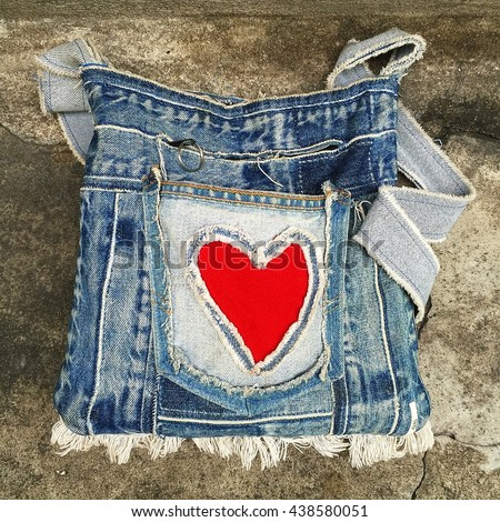 Bags recycling pocket red heart-shaped craft fashion background jeans fashion design vintege - stock photo