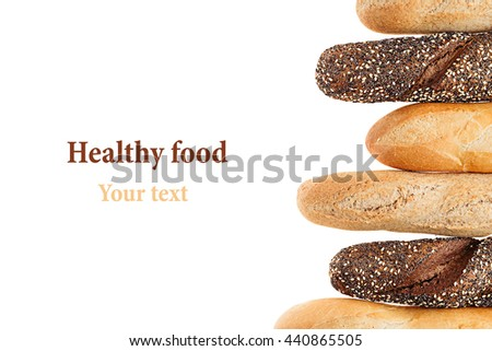 Baguette bread of different varieties on a white background. Rye, wheat and whole grain bread. Isolated. Decorative frame of bread. Food background. Copy space.