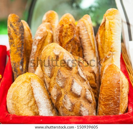 Baguette in the basket, French bread - stock photo