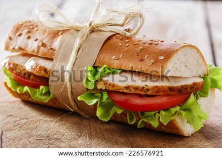 baguette sandwich with grilled chicken and tomatoes - stock photo