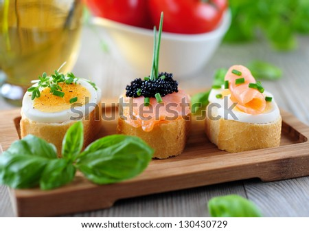 baguette sandwich with salmon, eggs and caviar
