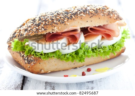 baguette with egg and ham - stock photo
