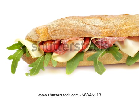 Baguette with salami and cheese in front of a white background