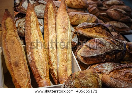 Baguettes and group of baked goods from a bakery - stock photo