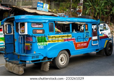 BAGUIO CITY, PHILIPPINES - APR 24:  A jeepney transports passengers in Baguio City, Philippines on April 24, 2014. Jeepneys are known for being colorful.