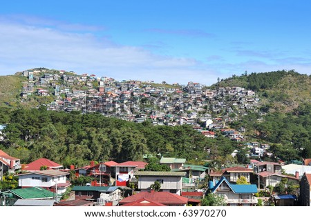 BAGUIO CITY, PHILIPPINES - DECEMBER 1: Cluster of various houses built on a hill in the City of Baguio, Philippines. Photo taken in December 1, 2009 in Baguio City, Philippines. - stock photo