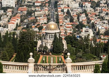 Bahai gardens on the slopes of the Carmel mountain, Haifa city and harbor, Israel - stock photo