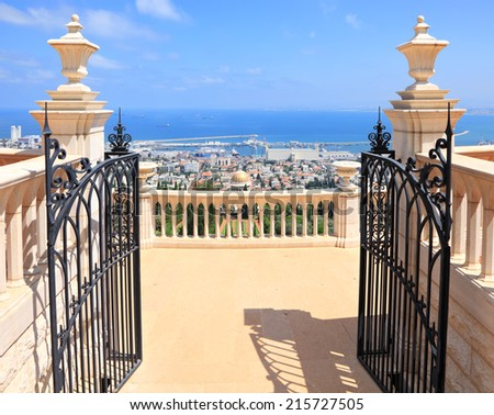 Bahai gardens terrace open forget gate and view of the Mediterranean Sea, Haifa city and harbor, Israel   - stock photo