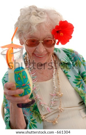 Bahama mama super senior woman with tropical drink and Hibiscus in her hair. - stock photo
