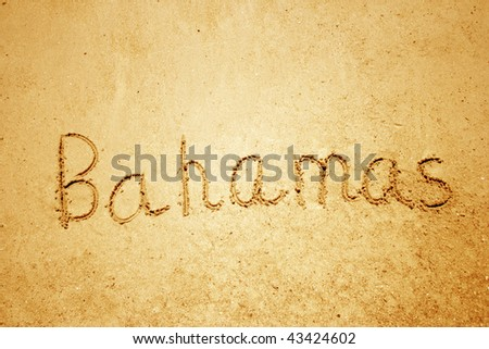 Bahamas handwritten in sand for natural, symbol,tourism or conceptual designs - stock photo