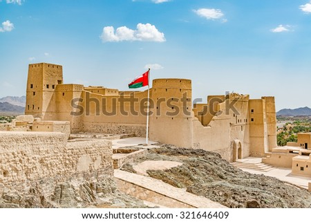 Bahla Fort is one of four historic fortresses situated at the foot of the Djebel Akhdar highlands in Oman. It has led to its designation as a UNESCO World Heritage Site and is known as Qal'at Bahla'. - stock photo