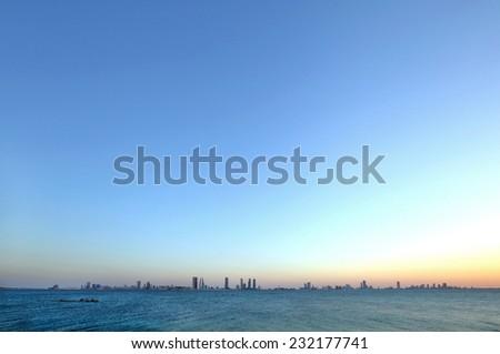 Bahrain skyline from Busaiteen beach, HDR photograph - stock photo