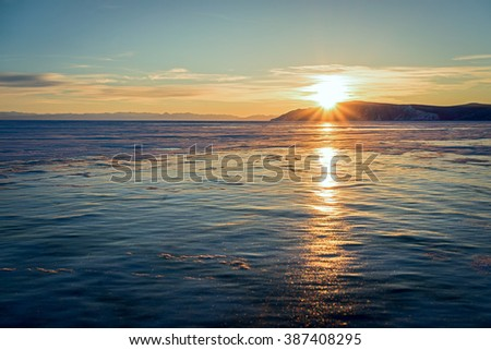 Baikal lake at sunset in winter - stock photo