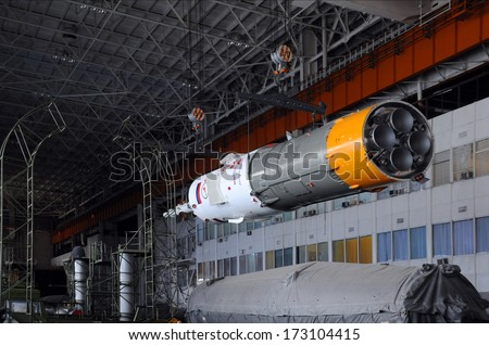 BAIKONUR, KAZAKHSTAN - DECEMBER 18, 2011: Part of Soyuz spacecraft is being relocated in Integration facility building for further assembly at Baikonur cosmodrome - stock photo