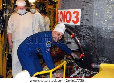 BAIKONUR, KAZAKHSTAN -?? NOVEMBER 12, 2014: Cosmonaut Anton Shkaplerov before entering Soyuz TMA-15M spacecraft hatch for a fit check in the Baikonur Cosmodrome Integration Facility - stock photo