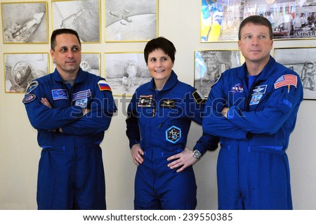 BAIKONUR, KAZAKHSTAN - NOVEMBER 19, 2014: ISS Expedition 42/43 crewmembers A.Shkaplerov (left), S.Cristoforetti (center) and T.Virts in the Space Museum - stock photo