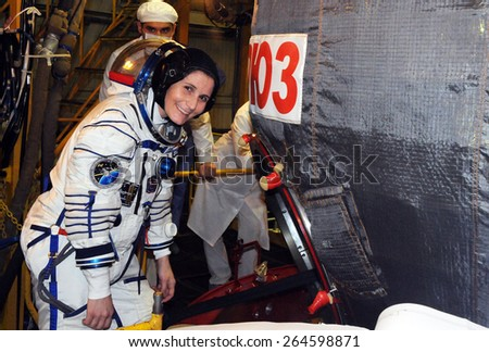 BAIKONUR, KAZAKHSTAN -?? NOVEMBER 12, 2014: NASA flight engineer S.Cristoforetti before entering Soyuz TMA-15M spacecraft hatch for a fit check in the Baikonur Cosmodrome Integration Facility. - stock photo