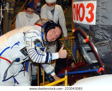 BAIKONUR, KAZAKHSTAN - NOVEMBER 12, 2014: NASA Flight engineer Terry Virts offers a thumbs up as he enters Soyuz TMA-15M spacecraft for fit check in the Baikonur Cosmodrome Integration Facility. - stock photo