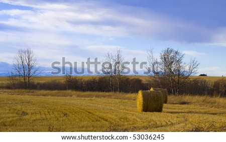 Bail of Hay with vivid sky and Mountains in background