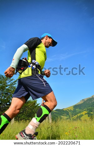 BAILE HERCULANE - JUNE, 8: Trail runner at the Hercules Maraton, fifth edition, in Cernei Mountains, Romania, June 8th, 2014 - stock photo