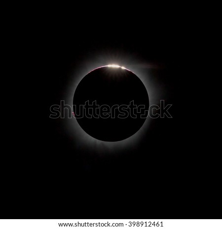 Bailys beads and internal corona during a total solar eclipse on March 9, 2016. An observation from Tidore island. Maluku Utara, Indonesia (This is an original photo! Not NASA public pictures!) - stock photo