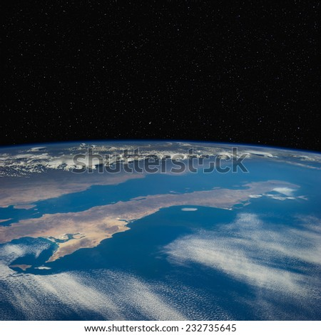 Baja peninsula of California from space with stars in the background. Elements of this image furnished by NASA. - stock photo