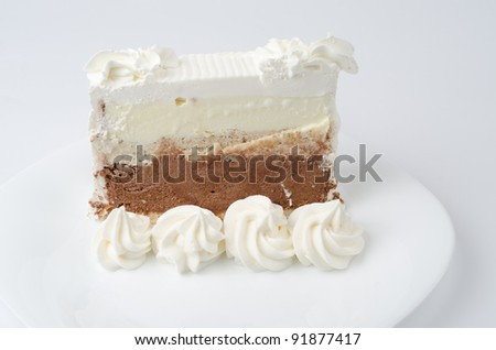 Bajadera cake with almonds, hazelnuts, walnuts and chocolate. - stock photo