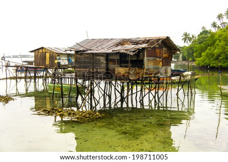 bajau house early morning with fog - stock photo