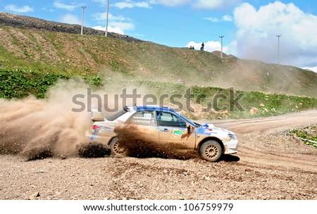 BAKAL, RUSSIA - AUGUST 8: Annual Rally Southern Ural, Anton Zinoviev's Subaru Impreza WRC WRX (No. 8) competes at the annual Rally Southern Ural on August 8, 2008 in Bakal, Chelyabinsk region, Russia. - stock photo