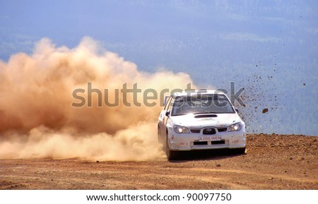 BAKAL, RUSSIA - AUGUST 3: Evgeniy Sapogov's Subaru Impreza (No. 18) competes at the annual Rally Southern Ural on August 3, 2007 in Bakal, Satka district, Chelyabinsk region, Russia. - stock photo