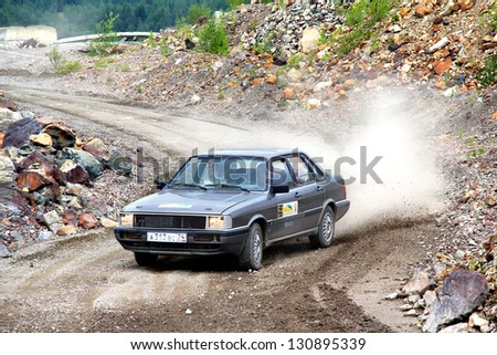 BAKAL, RUSSIA - AUGUST 21: Konstantin Berezin's Audi 80 (No. 59) competes at the annual Rally Southern Ural on August 21, 2012 in Bakal, Satka district, Chelyabinsk region, Russia. - stock photo