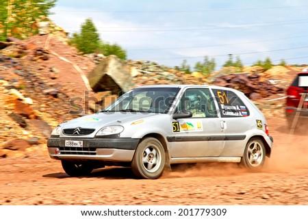 BAKAL, RUSSIA - JULY 21, 2012: Alexander Shuvalov's Citroen Saxo (No. 51) competes at the annual Rally Southern Ural. - stock photo