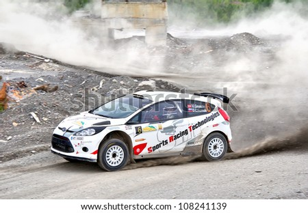 BAKAL, RUSSIA - JULY 21: Vasiliy Gryazin's Ford Fiesta (No. 6) competes at the annual Rally Southern Ural on July 21, 2012 in Bakal, Satka district, Chelyabinsk region, Russia. - stock photo